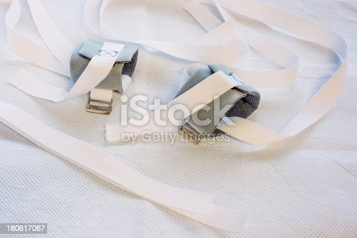 Wrist restraints on a hospital bed underpad