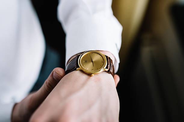 Wrist watch on a man's hand stock photo