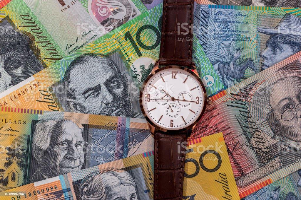 Wrist watch on australian dollars banknotes as background stock photo
