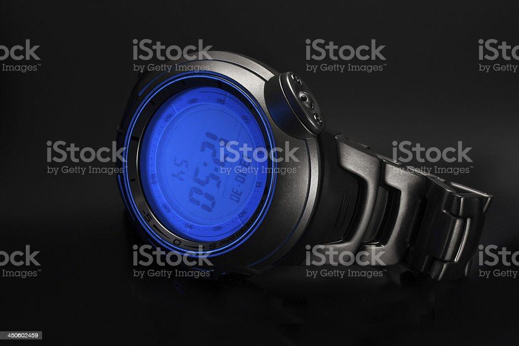 Wristwatch on a black background royalty-free stock photo