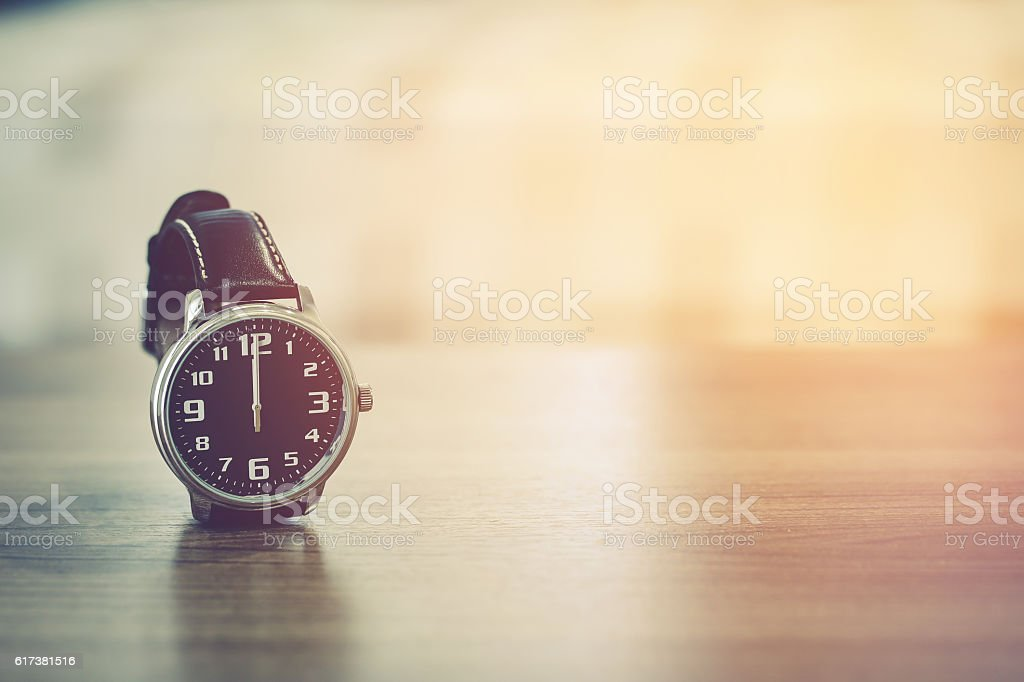 wristwatch on the table stock photo