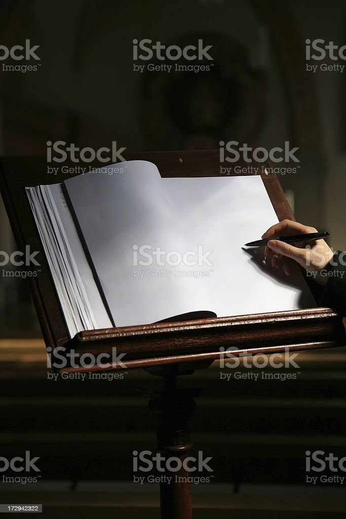 Write in the guestbook royalty-free stock photo