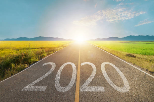 2020 write on road with new planning and goals to success ideas and concept. stock photo