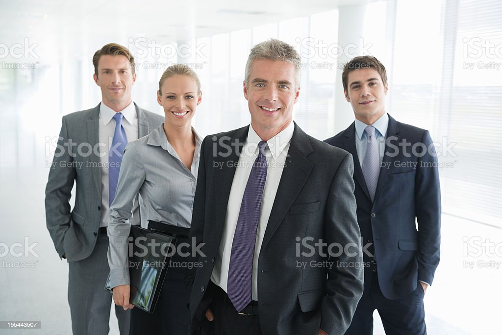 Write the title... Four people in business dress. stock photo