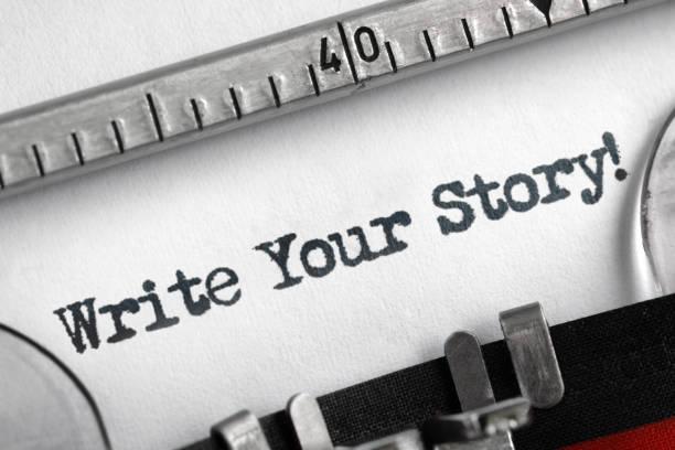 Write your story written on typewriter - foto de acervo