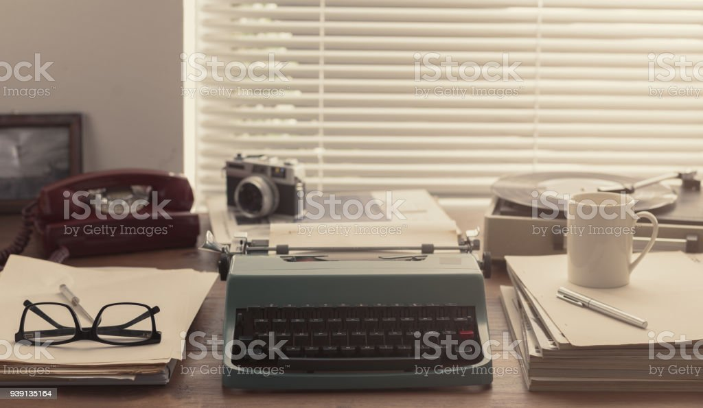 Writer and journalist vintage desktop with typewriter stock photo