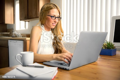 istock Writer blogger independent freelance blog journalist working typing home computer 488792074