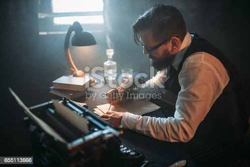 655113470 istock photo Writer in glasses writes novel with a feather 655113666