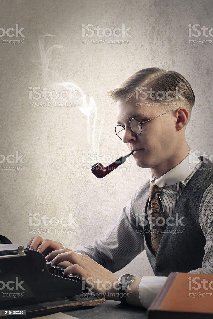 Writer using vintage typewriter stock photo