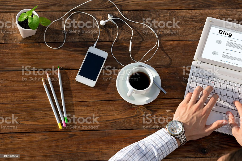 Writer Working on Computer at Wooden Desk stock photo