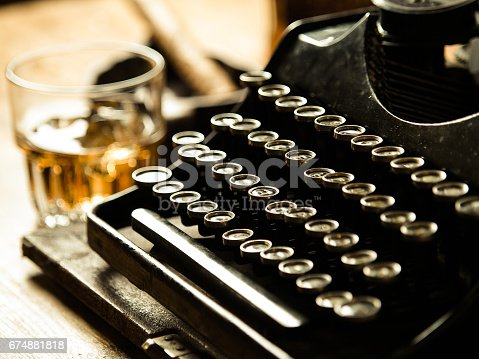 istock Writer's night with a glass of whiskey 674881818