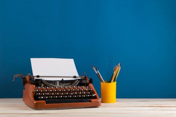 Writers workplace red typewriter and stationery on blue blackboard picture id1189981027?b=1&k=6&m=1189981027&s=612x612&w=0&h=j 3w5pgurbt fsxq364lxdvrrvtzlvkxujpyvhgcnou=