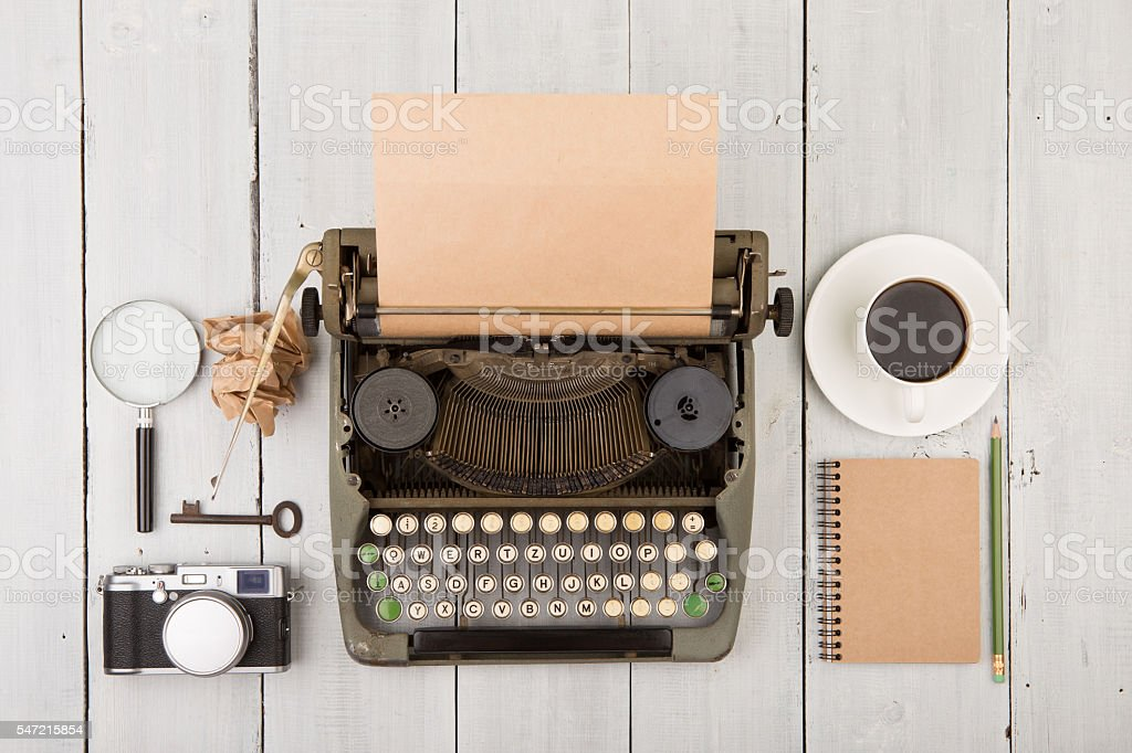writer's workplace - wooden desk with typewriter stock photo