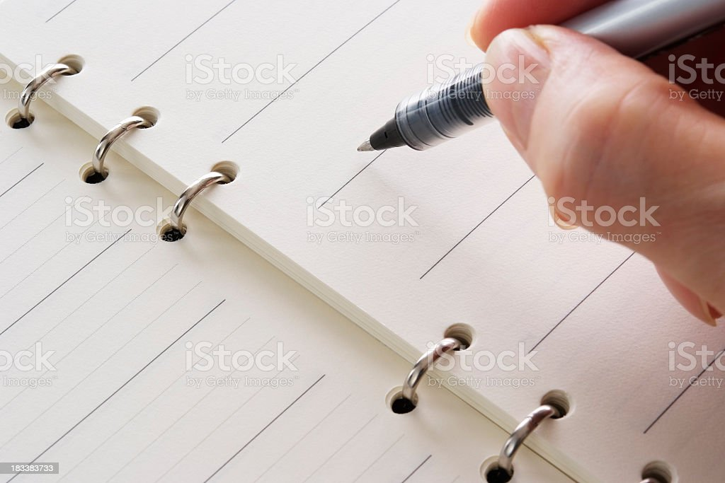 Writing a blank diary with shallow depth of field royalty-free stock photo
