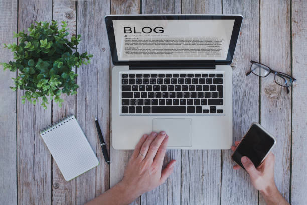 writing a blog, blogger influencer reading text on screen stock photo