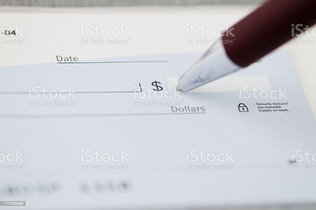 Writing a check. royalty-free stock photo