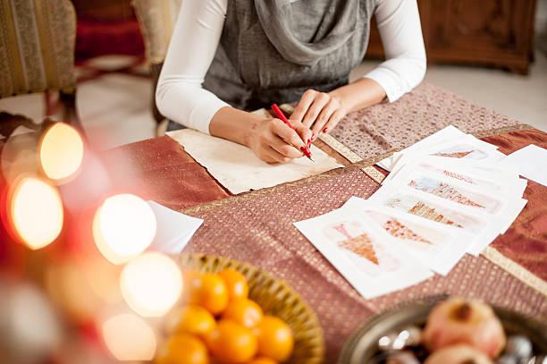 writing a christmas card - weihnachtskarte stock-fotos und bilder