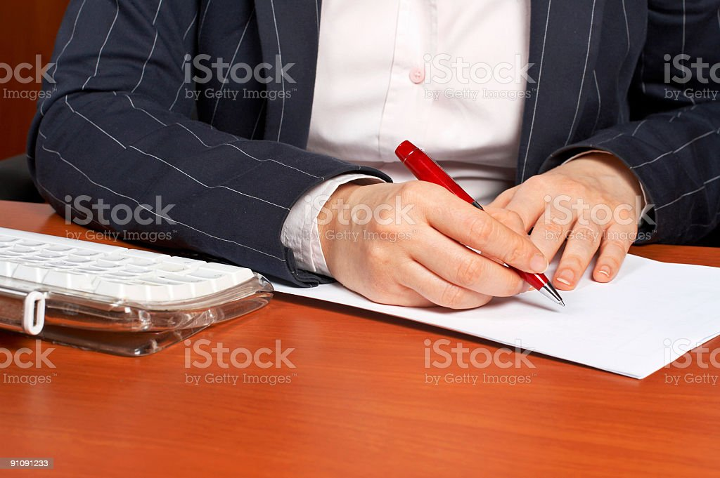 Writing a contract royalty-free stock photo