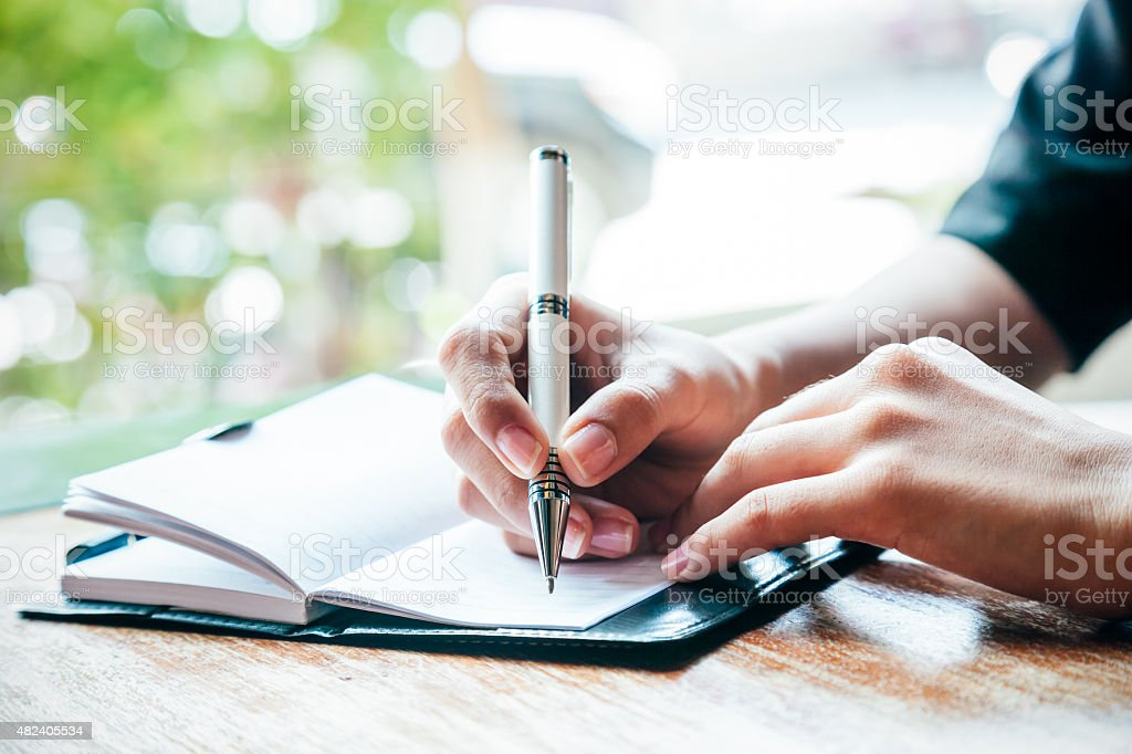 writing a journal stock photo