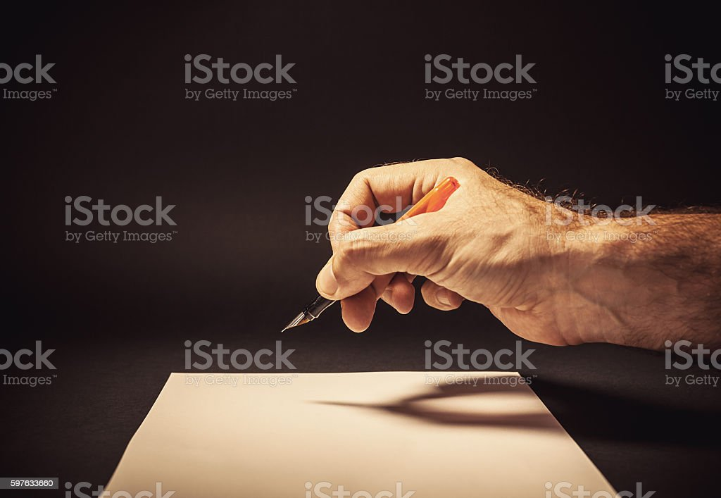 Writing a Letter by a Man stock photo