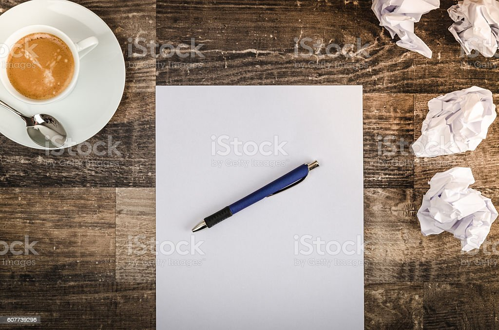 White empty paper, cup of coffee and crumpled paper on an old...