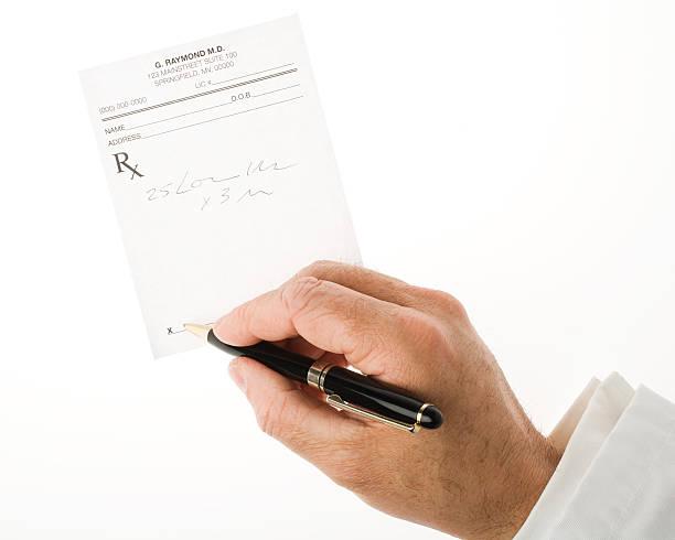 Writing a prescription stock photo
