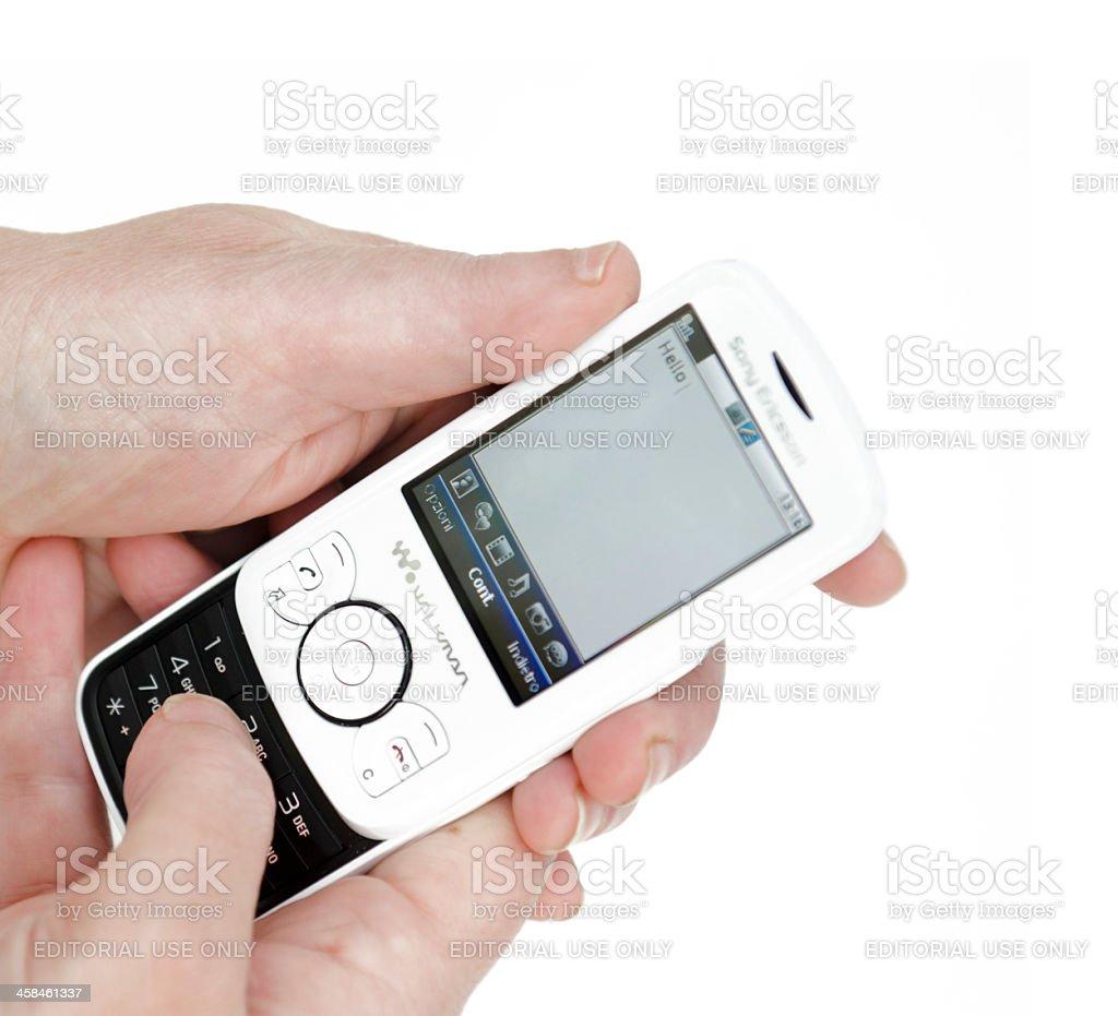 Writing a text sms with Sony Ericsson Spiro walkman phone stock photo