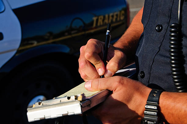 writing a ticket - ticket stock photos and pictures