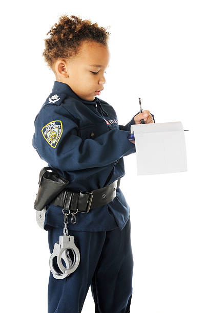 writing a ticket - boy handcuffs stock pictures, royalty-free photos & images