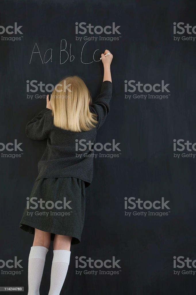Writing ABC on a blackboard royalty-free stock photo