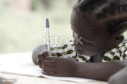 istock Writing and Learning Symbol: Cute African Schoolgirl Doing Homework 492668072