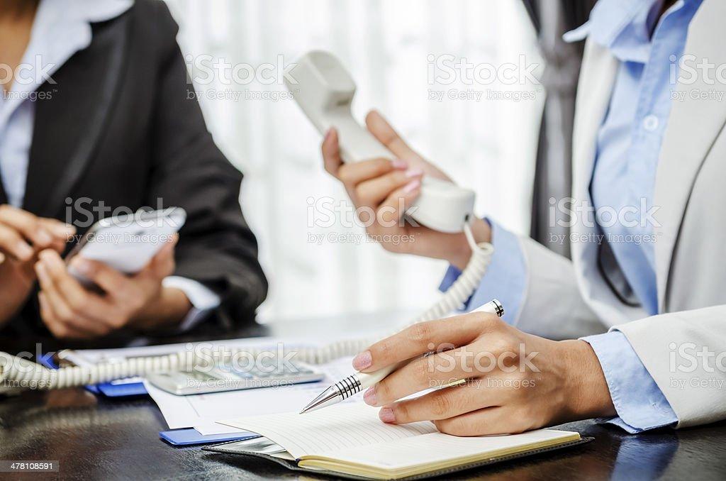 Writing and telephone stock photo