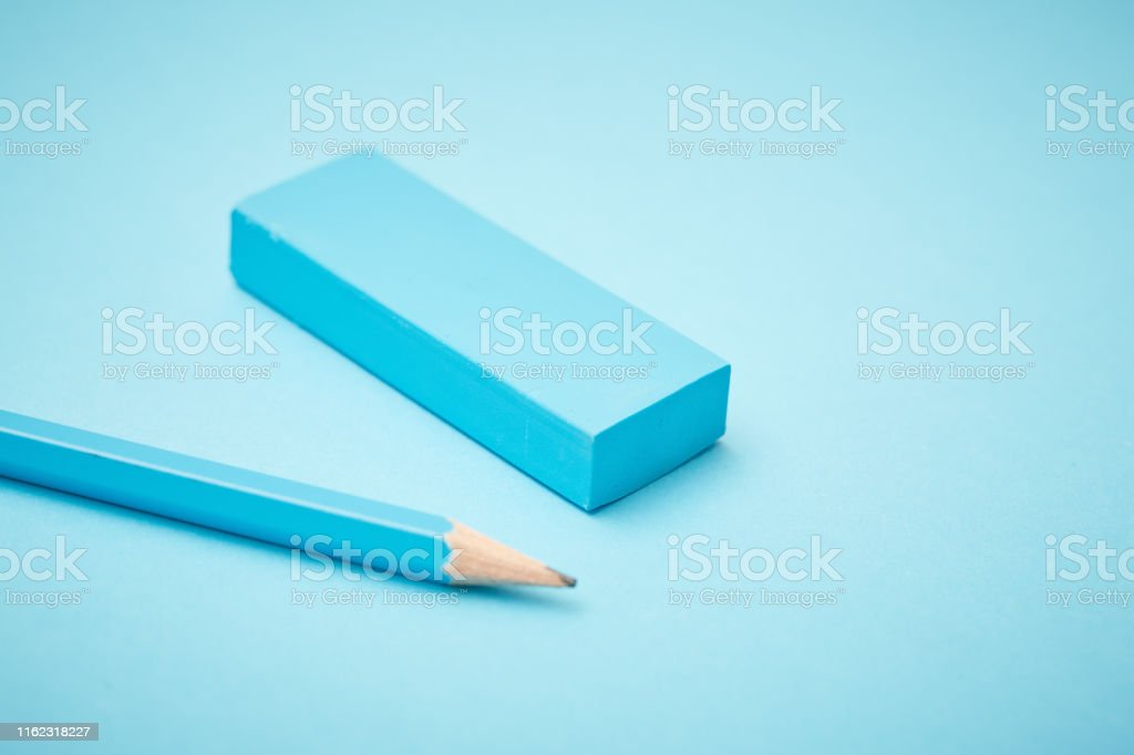 A lead pencil and an eraser on a blue background.