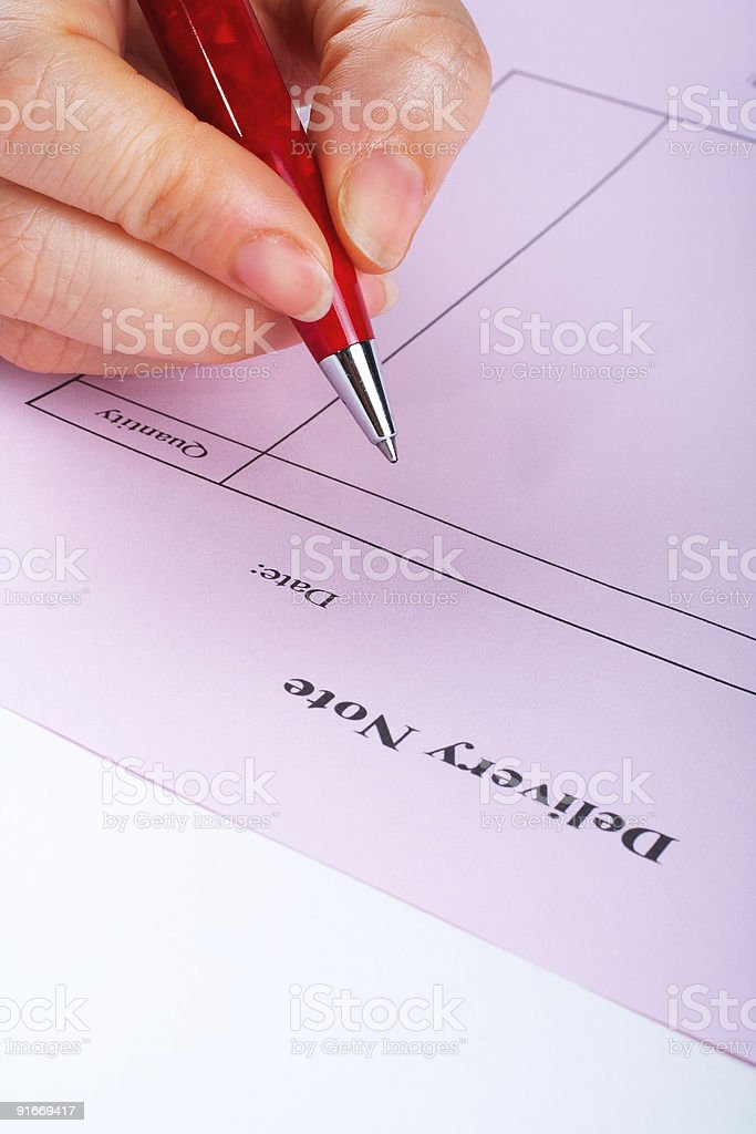Writing blank delivery note with pen stock photo