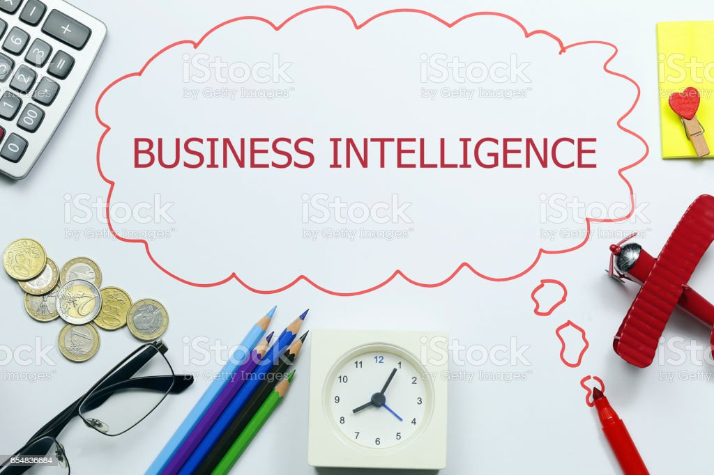 writing business intelligence with marker on red talking bubble paper stock photo
