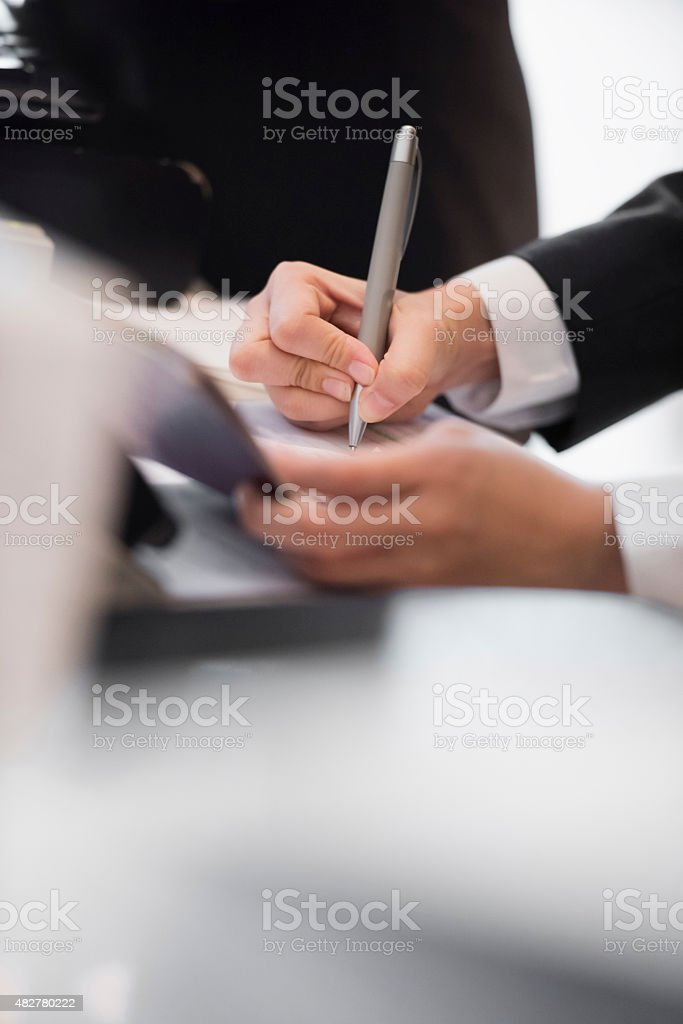 Writing business notes stock photo