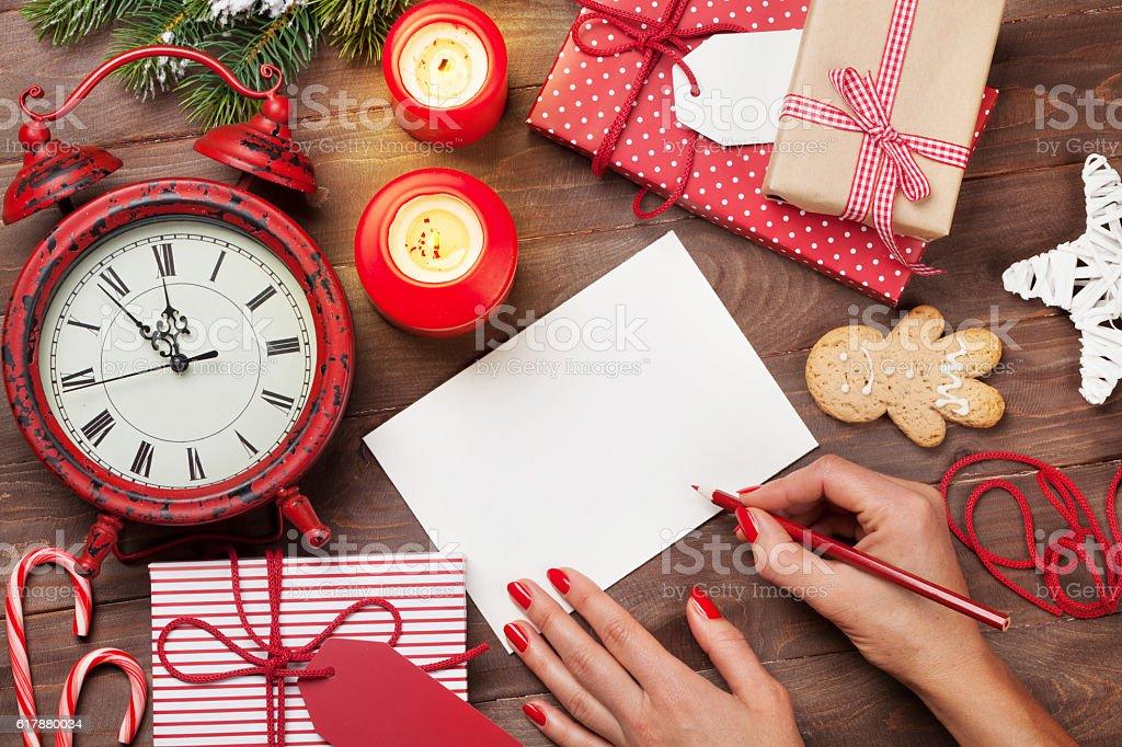 Writing christmas greeting card stock photo