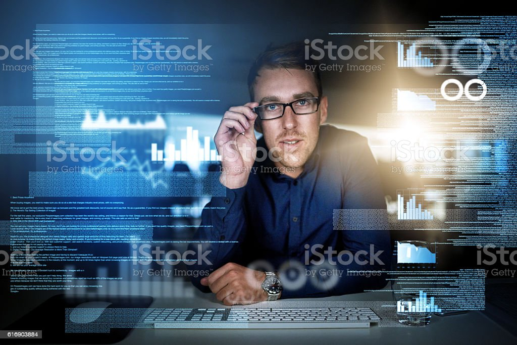 Writing code is what he does stock photo