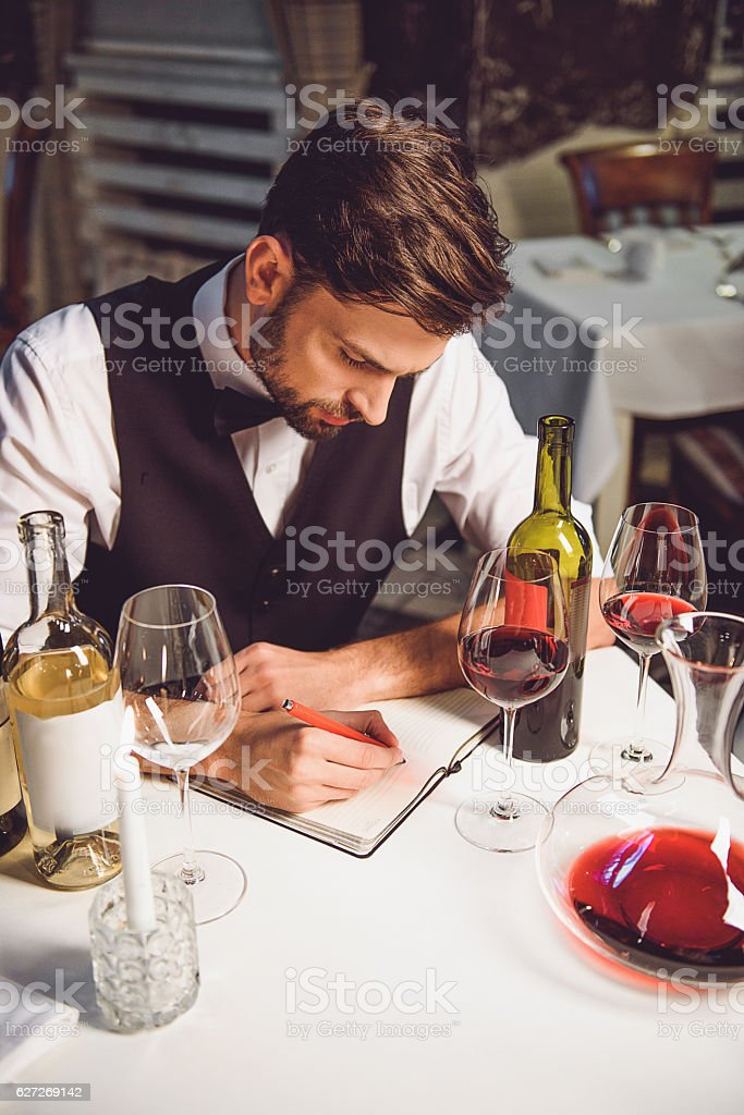Writing comment about wine collection stock photo
