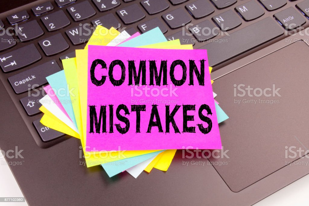 Writing Common Mistakes text made in the office close-up on laptop computer keyboard. Business concept for Common Decision Mistakes Workshop on the black background with copy space stock photo