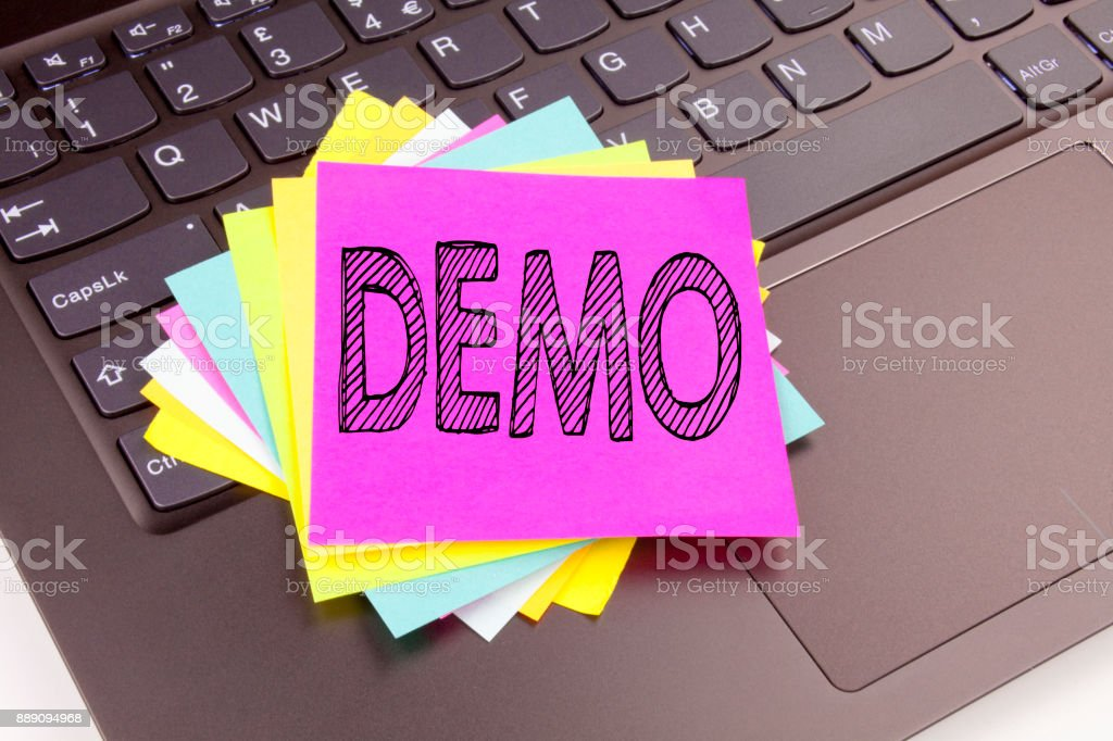 Writing Demo text made in the office close-up on laptop computer keyboard. Business concept for Software Demonstration Workshop on the black background with copy space stock photo