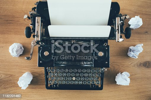 Vintage writing desk with retro typewriter.  Author, writer, journalism concept