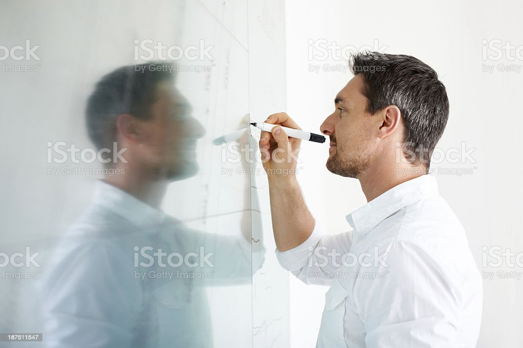 Writing down his creative thoughts stock photo