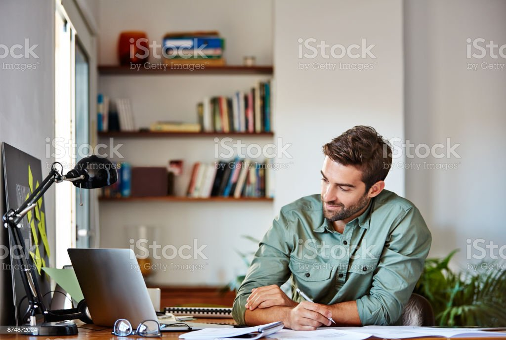 Writing down his plan of action stock photo