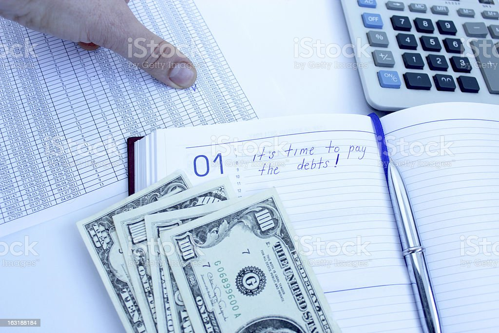 writing down in notebook about a debt royalty-free stock photo