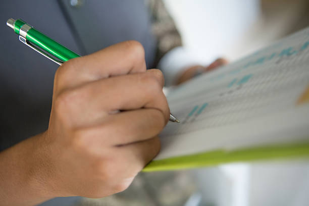 Writing down on checklist stock photo