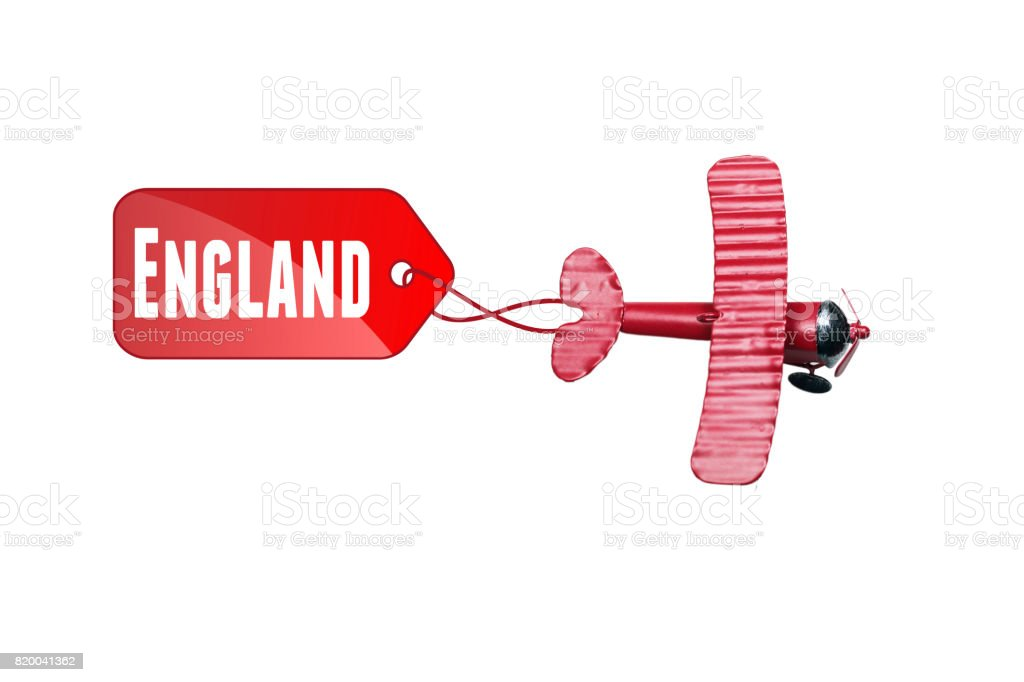 writing England red toy airplane with talk bubble on white background. Business holiday and travel concept stock photo