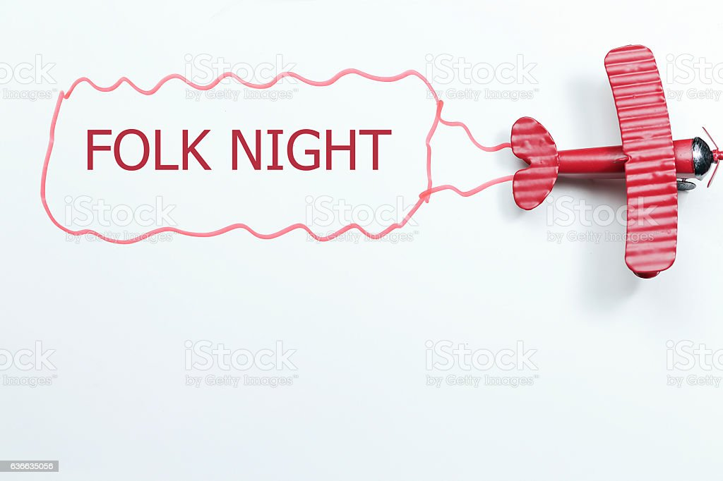 writing Folk Night red toy airplane with talk bubble stock photo