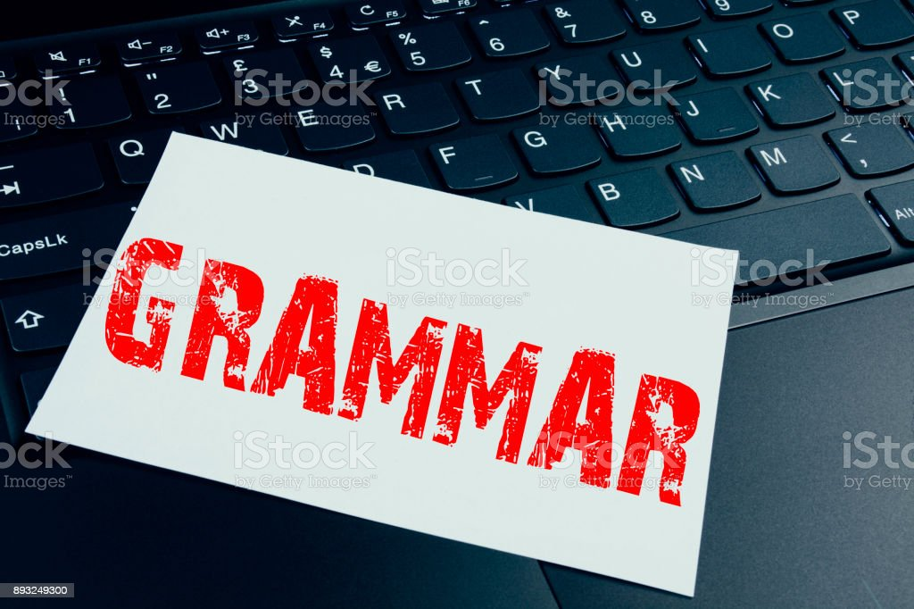 Writing Grammar text made in the office close-up on laptop computer keyboard. Business concept for  The Basic Rules of Syntax Grammatical Language Workshop on the black background with copy space stock photo