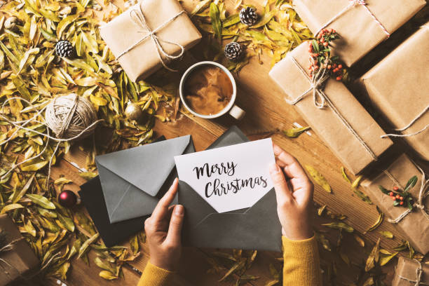Writing greeting cards, Christmas table top flat lay stock photo